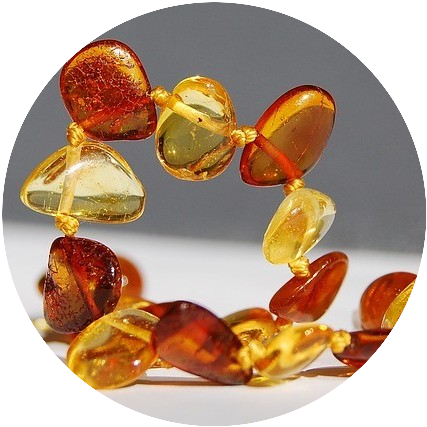 A curled string of amber beads